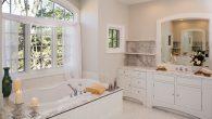 Custom white toned master bathroom with jacuzzi tub