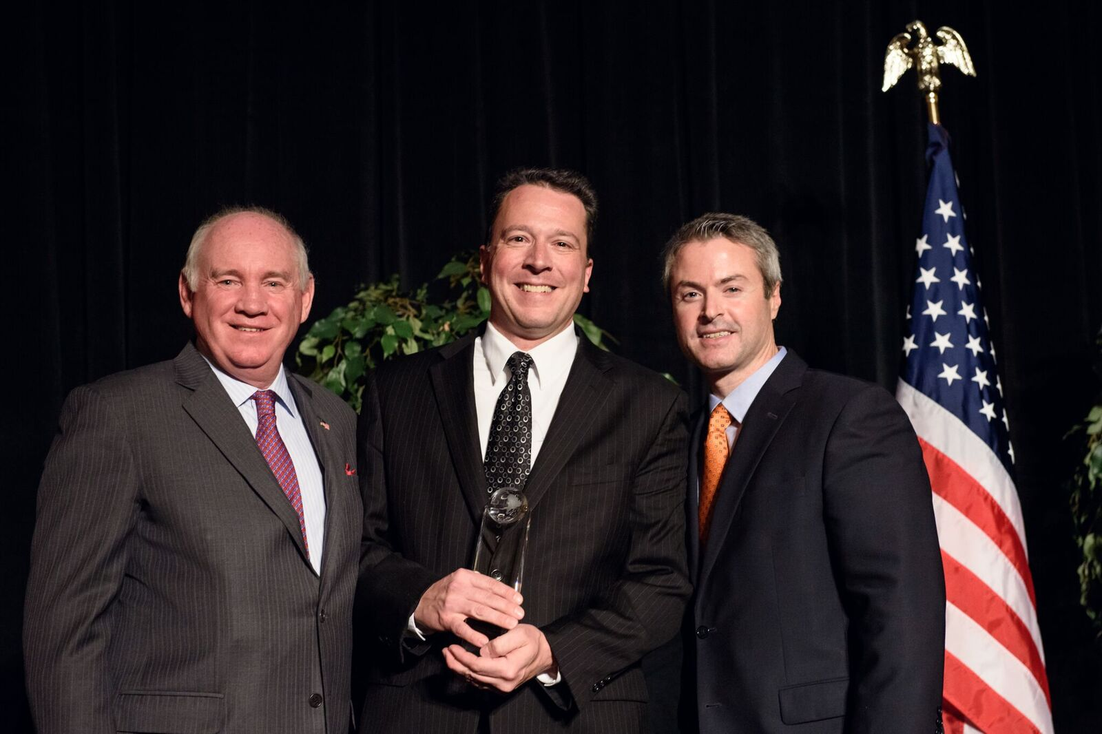 Patrick Bergner (center), CMO of Berkshire Hathaway HomeServices KoenigRubloff Realty Group, accepts the RISMedia Tech Titan Award on behalf of Nancy Nagy, broker/owner of Berkshire Hathaway HomeServices KoenigRubloff Realty Group, with John Featherston (left), president and CEO of RISMedia, and David Mele (right), president of Homes.com, sponsor of the award.
