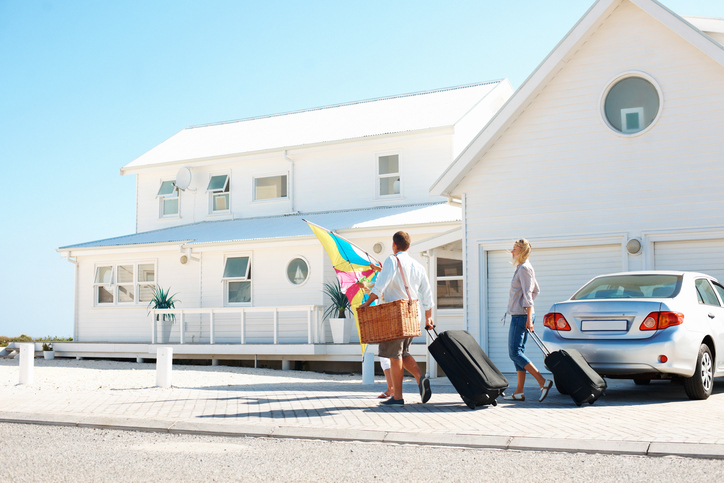Young family arriving at their holiday beach house