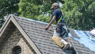 Roofing Contractors Replacing Damaged Roofs After a Hail Storm